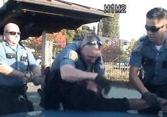 Screen capture from dashboard video of Etherly's arrest